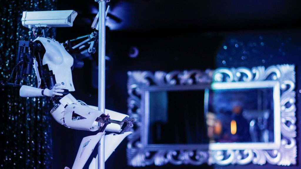 Robot pole dancers at nightclub