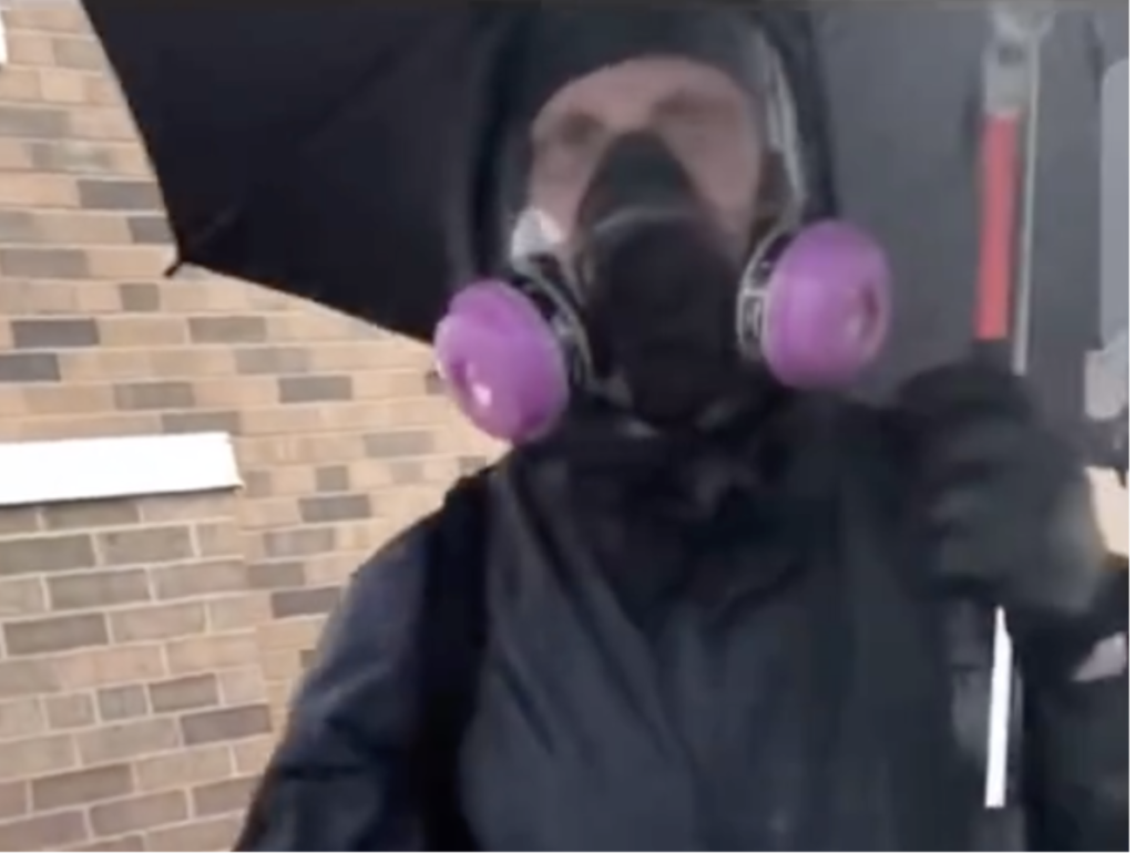 Questions raised over masked white man with umbrella seen calmly smashing windows before Minneapolis riots