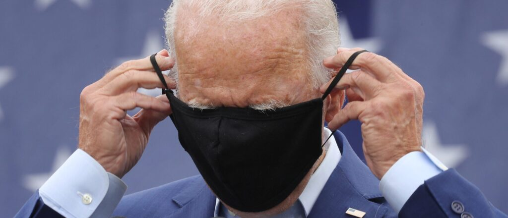 Joe Biden putting on a mask