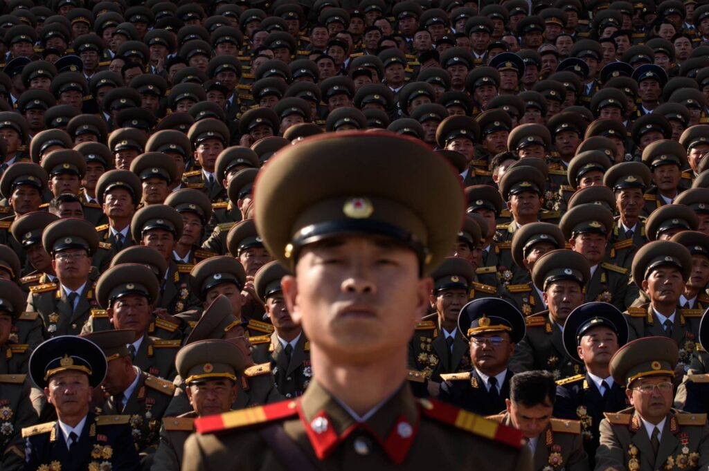 North Korean soldiers stand before spectators during a military parade in Pyongyang's Kim Il Sung square on Oct. 10, 2015. | AFP-JIJI