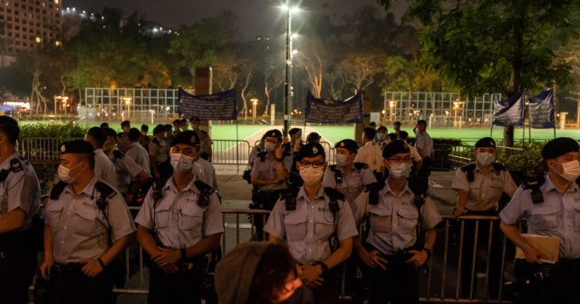 Hong Kong Police Seal Off Main Park, Arrest 19 on Chinese Takeover Anniversary
