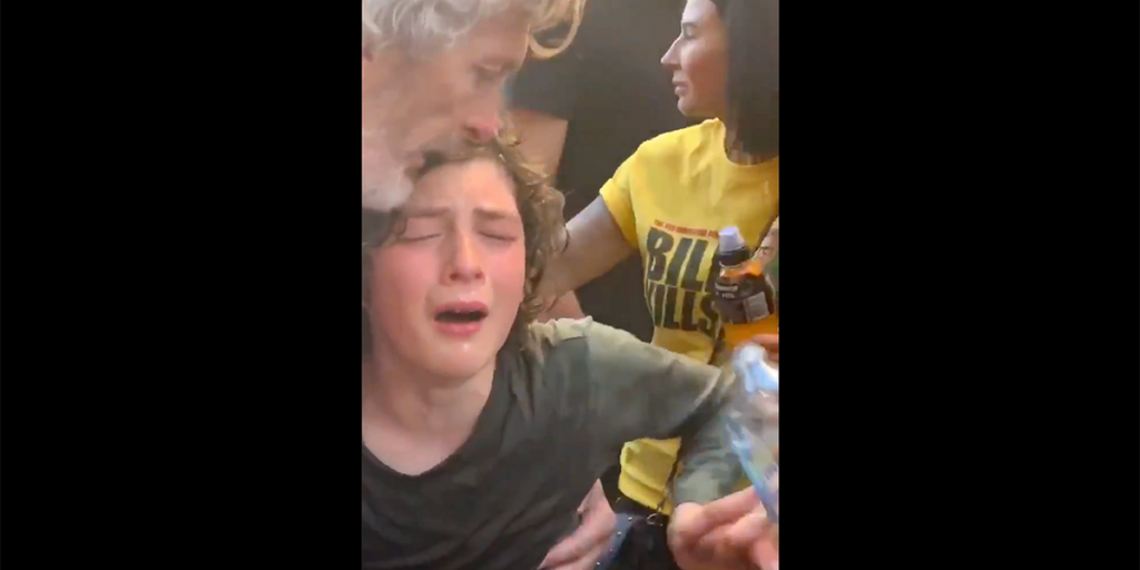 AUTHORITIES PEPPER SPRAY KID AT ANTI-LOCKDOWN PROTEST. SHE WAS HOLDING A SIGN THAT SAID 'LET ME PLAY'