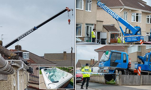Elderly crane firm worker is killed after hot tub falls on him while being lowered into a back garden