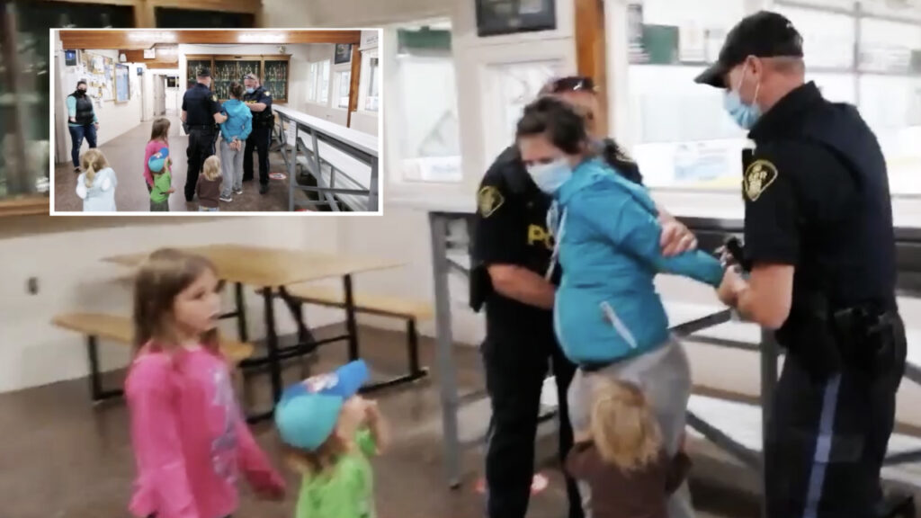 OPP arrest woman in front of crying children for not providing vaccination status to enter arena