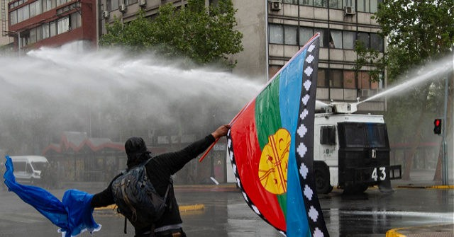oct10-21-riots-Santiago-Chile-Mapuche-indigenous-flag-getty-640x335.jpg